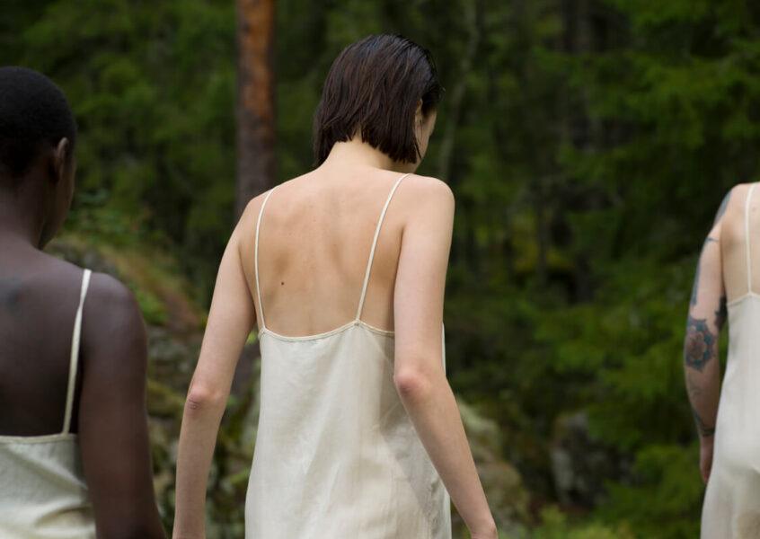 Wolva three women walking in forest