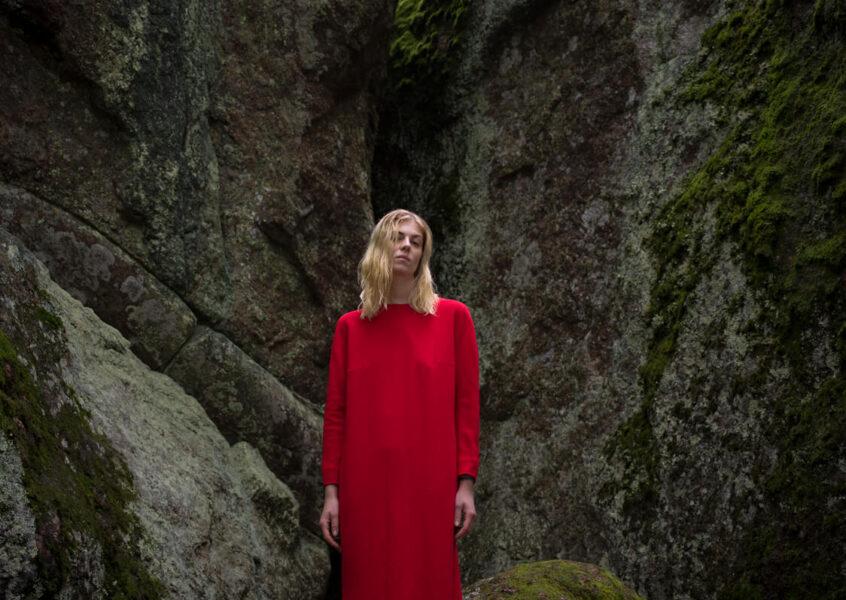 Wolva woman in red dress